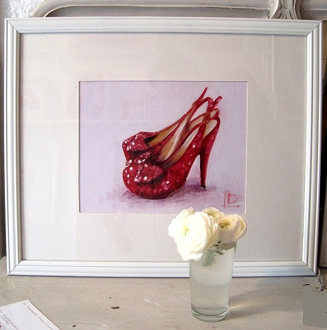 original oil painting of red sparkly shoes by Brighton artist Linda Boucher. Photographed in her brighton seafront studio.
