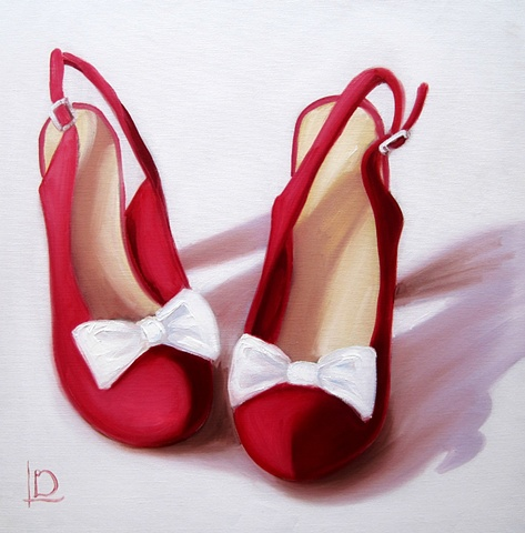 Do the two step with these red slingback shoes complete with white bows on the toes, by Brighton artist Linda Boucher