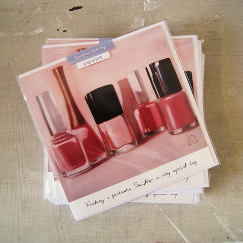 Bottles of pale pink nail polish adorn the front of this greetings card, commissioned and licensed by Paperlink.