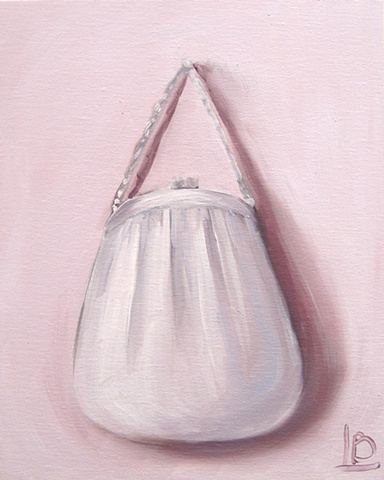 silver purse painted in oil paint by Brighton Artist Linda Boucher, in her art studio and gallery in Kings Road Arches, part of the Brighton Seafront Artist Quarter.