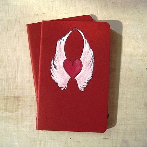 original artwork on a Moleskine Notebook, a classic tattoo design featuring a winged love heart by Linda Boucher.