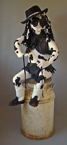 Mixed media sculpture of cow-like girl sitting on milk can by Marie Bergstedt