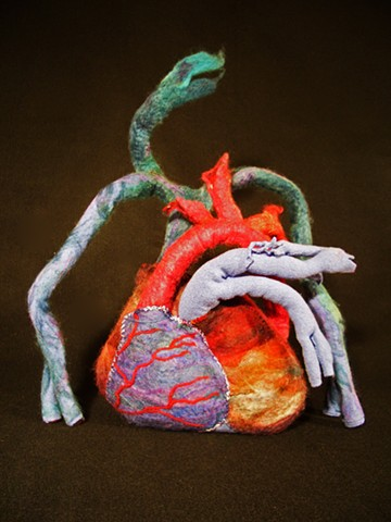 Mixed media sculpture of a human heart by Marie Bergstedt