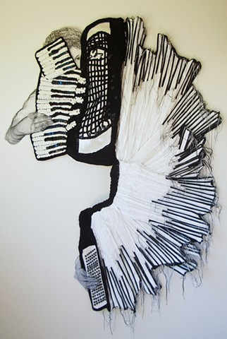3-D mixed media wall artwork of cascading accordian by Marie Bergstedt