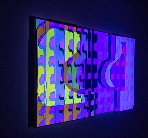 Animation is projected onto a wood wall relief.