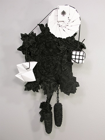 """The Ol' Magician at a Funeral Routine"" cuckoo clock, black on black paisley pattern, paper fortuneteller, handkerchief, Rubik's cube, and 13 spades"