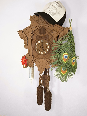 """Roll it Fast, Burn it Slow, Put on the Shades so the Boss Don't Know""; cuckoo clock, peacock feathers, rooster's comb, trucker hat, and caulk."