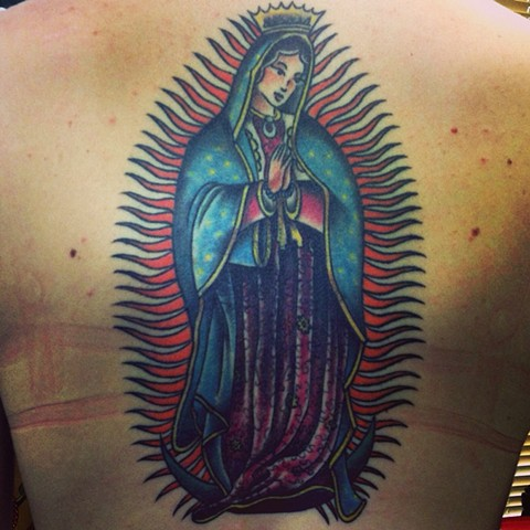 an old school, traditional tattoo of the Virgin de Guadelupe by vincent. vincentiusmaximus