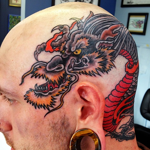 an old school, traditional dragon head tattoo by vincent. vincentiusmaximus