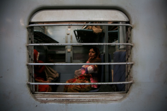 Woman on train; Bikaner, Rajasthan