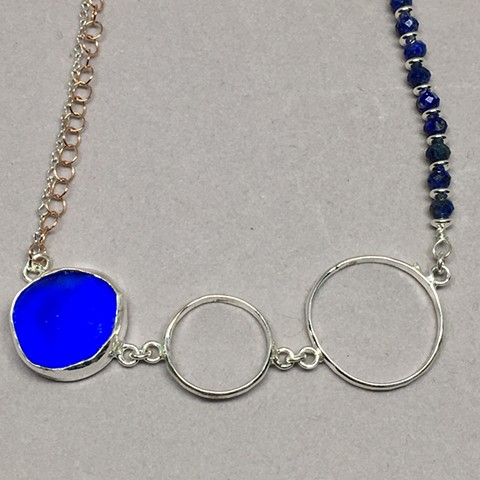 Asymmetrical necklace with cobalt seaglass and lapis.