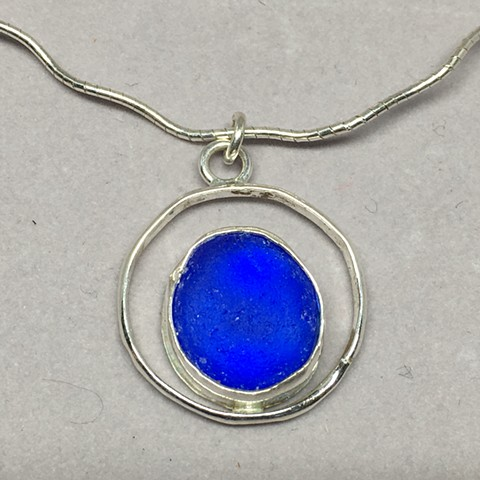 cobalt seaglass within a sterling circle.