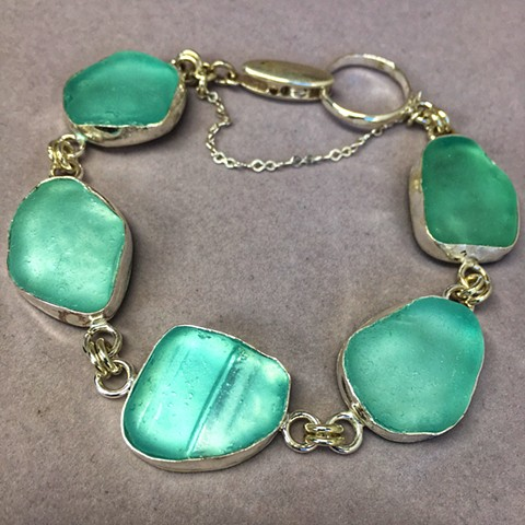 multi bezel aqua seaglass set in handcrafted fine silver bezels.