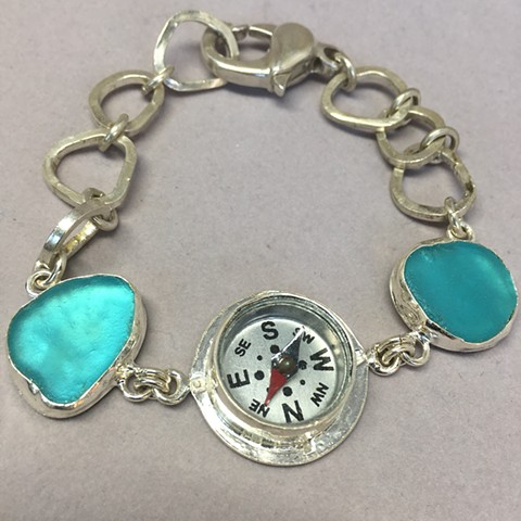 Compass set in fine silver with multi bezel aqua seaglass.