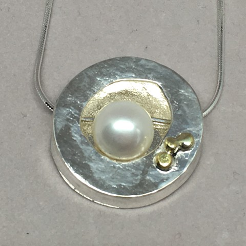 Lovely South Pacific Pearl within a fine silver circle box with 18K gold dots.