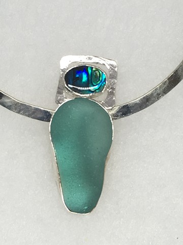 Paua Shell with exceptional piece of Aqua glass on a sterling collar