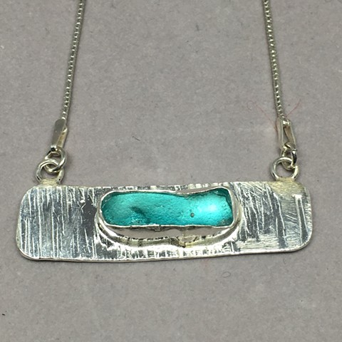 Aqua seaglass set on fine silver bar.