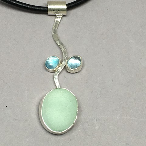 Seafoam green seaglass with 2 lovely aquamarine stones.