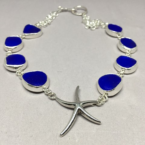 Sterling starfish with brilliant cobalt blue seaglass