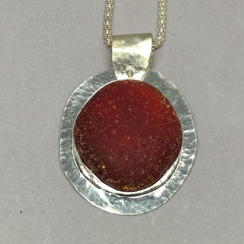 Large piece of ruby red seaglass set in fine silver bezels