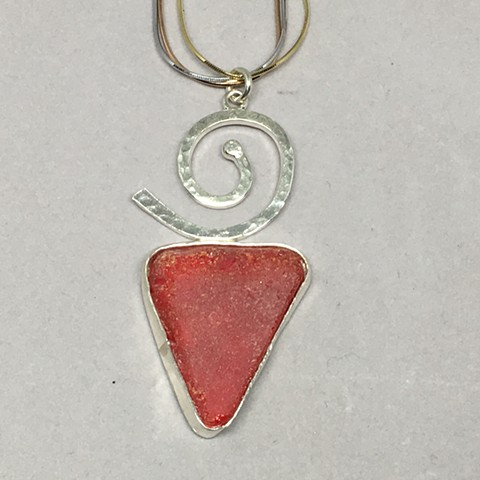Smaller piece of rare red seaglass