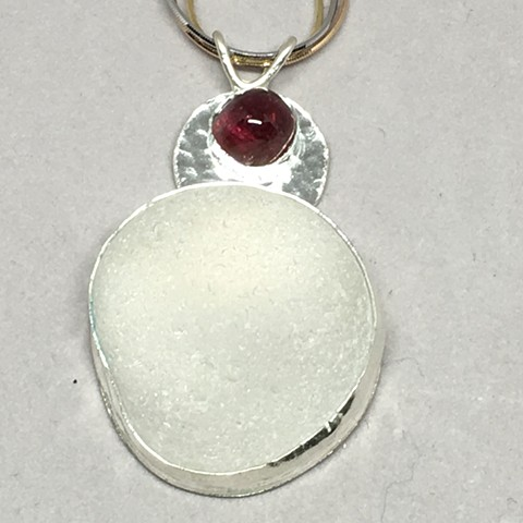 Lg piece of white seaglass with lg pink tourmaline stone