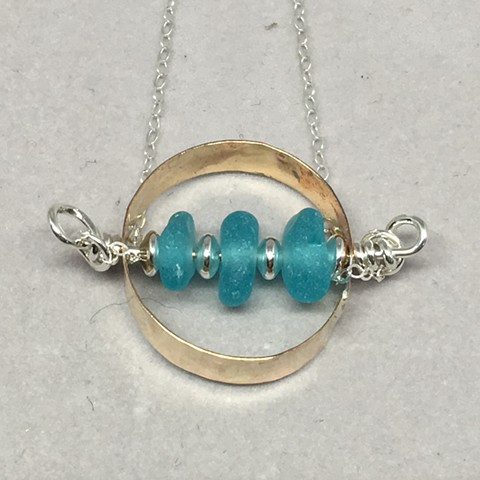Three little aqua pebbles in a 14K gold filled circle with a sterling chain