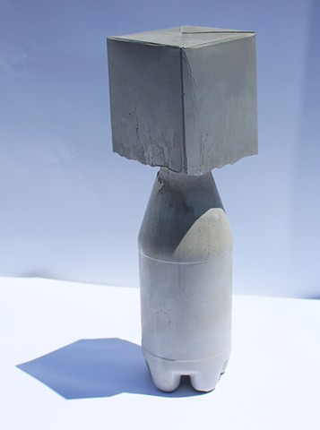 Cast concrete into found plastic bottle and milk carton
