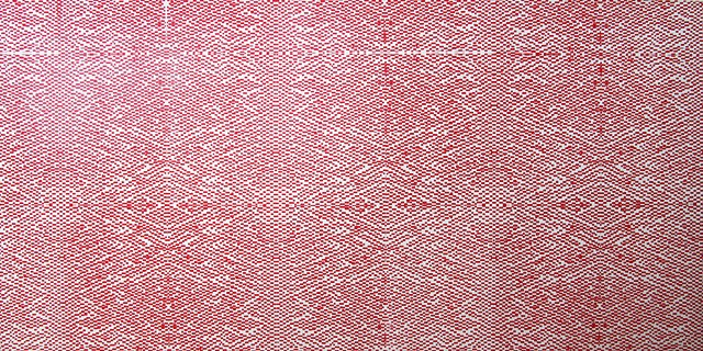 Red screenprint pattern on panel.