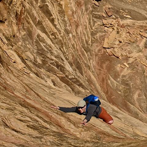 Hiker Descending Dry Falls Canyonlands NP   Apr 2010