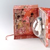 Mutted music box / 2008 / monotype, collage, digital printed images, paper clay, painting ,epoxy-resin / 6 x 8 x 4 (inches)