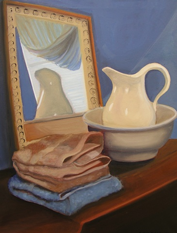 Pitcher and bowl with towels in mirror
