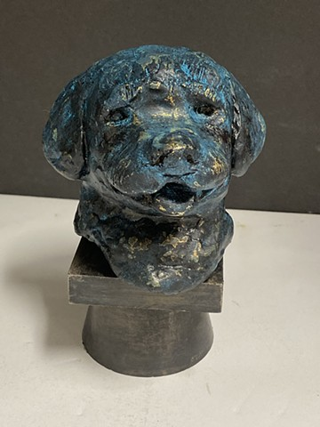 Small sculpture of golden retriever puppy