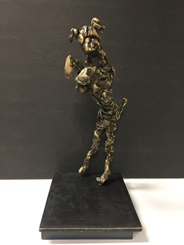 Bronze sculptureof dog dancing