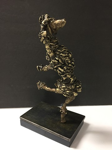 Bronze sculpture of dancing poodle