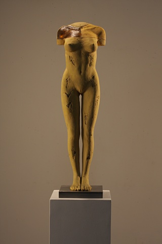 Nude sculpture by Dan Corbin features glass, wood bauxite.
