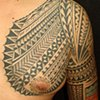 POLYNESIAN INSPIRED CHEST AND UPPER ARM TATTOO