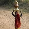 Woman Carrying Pots