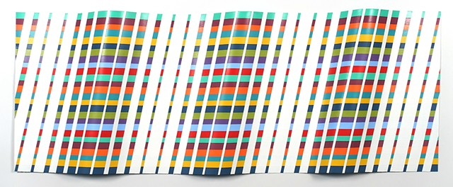 Wall sculpture painted with striped design