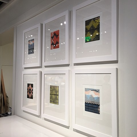 A grouping of framed prints on a wall