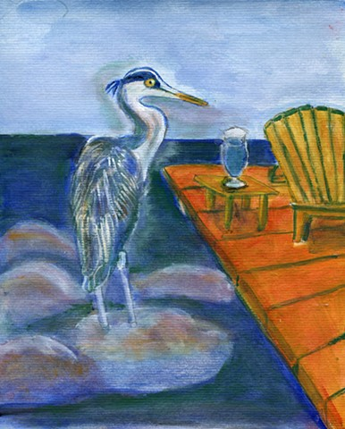 Blue Heron standing in blue water