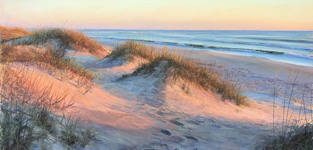 A breathtaking sunrise over the Outer Banks painted the dunes in radiant pink.