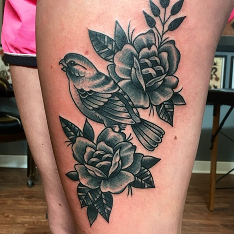black and grey bird and flowers tattoo thigh