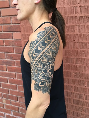 healed black and grey mandala patterns