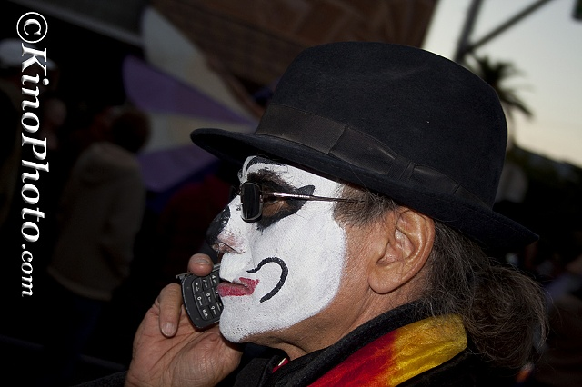 "Man with a cell phone at All Souls Procession.  ""Can you hear me now"""