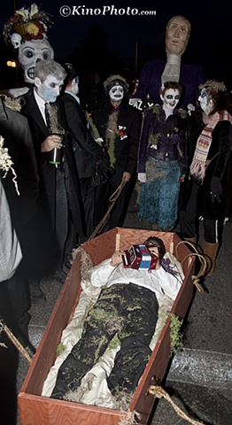 Squeezebox in coffin.  He was pulled the entire route by friends.
