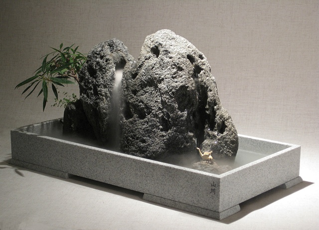 zen indoor fountain rock sculpture with waterfall and bird figure