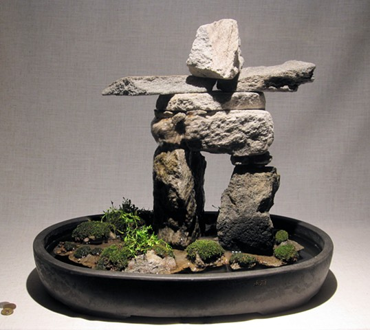 miniature innunguaq fountain of feather rock with centaurium, mosses, and fogger