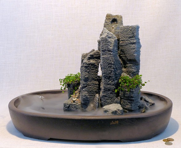 tabletop feather rock fountain with fog, ivy, handmade bird, and mudman figure