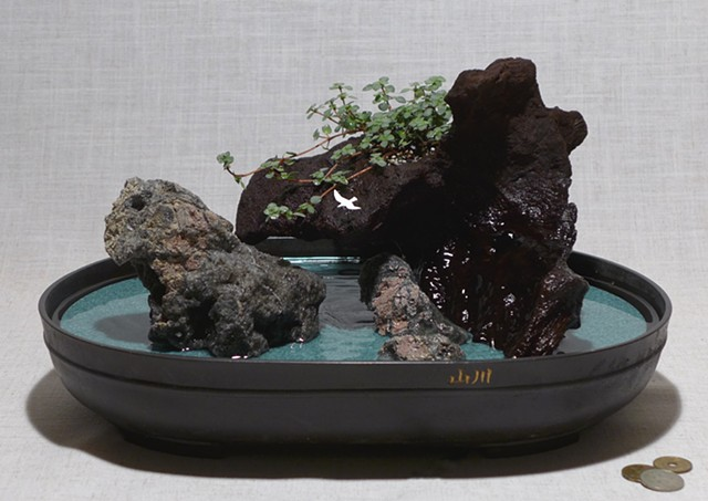 feather rock fountain with live plant, waterfall, driftwood, reclaimed Corian, and handmade bird figurine